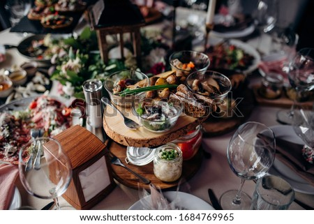 dishes at the wedding table Royalty-Free Stock Photo #1684769965