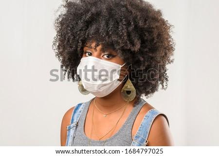 young girl wearing protective mask in corona virus pandemic, covid-19 #1684797025