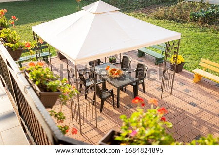 Patio with garden furniture and parasol Royalty-Free Stock Photo #1684824895