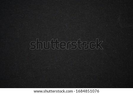 Black paper background with radial gradient vignette