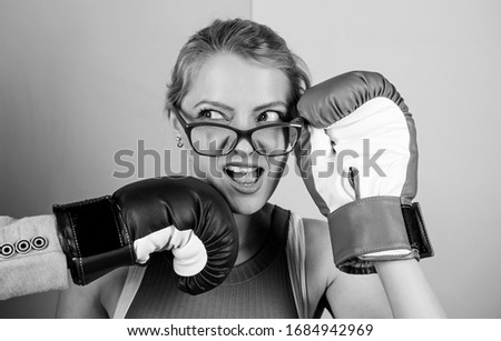Strong punch. Hand in boxing glove punching female face. Painful punch. Teeth pain concept. Defenseless head. Suffering. Punch in face. Destroy beauty. Cosmetology and plastic surgery services. #1684942969
