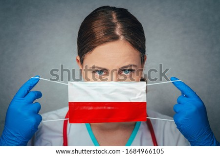 Coronavirus in Poland Female Doctor Portrait hold protect Face surgical medical mask with Poland National Flag. Illness, Virus Covid-19 in Poland, concept photo Royalty-Free Stock Photo #1684966105