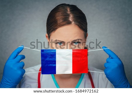 Coronavirus in France. Female Doctor Portrait hold protect Face surgical medical mask with France National Flag. Illness, Virus Covid-19 in France, concept photo #1684972162