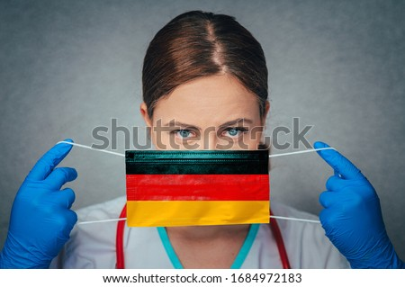 Coronavirus in Germany, Deutschland Female Doctor Portrait hold protect Face surgical medical mask with Germany National Flag. Illness, Virus Covid-19 in Germany, concept photo #1684972183