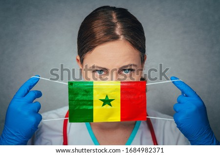 Coronavirus in Senegal Female Doctor Portrait hold protect Face surgical medical mask with Senegal National Flag. Illness, Virus Covid-19 in Senegal, concept photo #1684982371