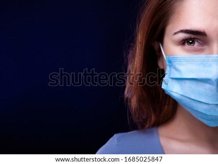 Closeup Beauty Woman in Medical Mask. Half face #1685025847