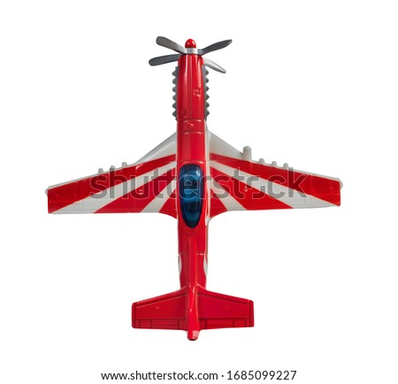 Isolated photo of a race sport airplane toy on white background upper view.