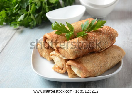 Pancakes stuffed with meat, herbs. Russian or Ukranian cuisine.Homemade baking. Delicious lunch or supper Royalty-Free Stock Photo #1685123212