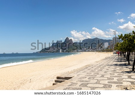 Deserted Ipanema and Leblon beach with the Two Brothers mountain in the background during the COVID-19 Corona virus outbreak on a sunny midday in Rio de Janeiro, Brazil #1685147026