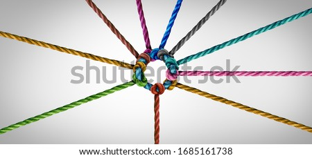 Concept of team unity and teamwork idea as a business metaphor for joining a partnership as diverse ropes connected together as a corporate symbol for cooperation and working collaboration. Royalty-Free Stock Photo #1685161738