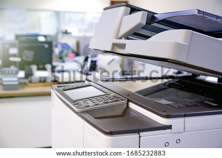The photocopier or network printer is office worker tool equipment for scanning and copy paper. Royalty-Free Stock Photo #1685232883