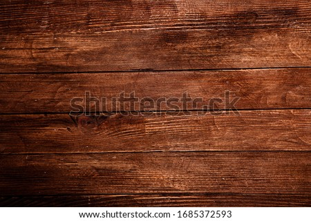 Vintage brown wood background texture with knots and nail holes. Old painted wood wall. Brown abstract background. Vintage wooden dark horizontal boards. Front view with copy space. Background for des #1685372593