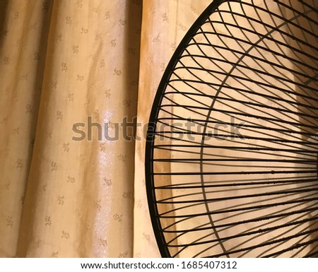 Close up photo of Fan's steel cage #1685407312