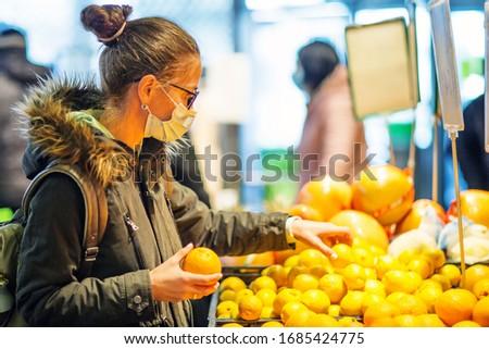 Caucasian woman shopping wearing mask #1685424775