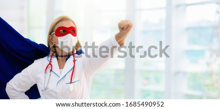 Doctor or nurse wearing surgical face mask in superhero cape. Medical staff during coronavirus outbreak. Super hero power for clinic and hospital personal. Royalty-Free Stock Photo #1685490952