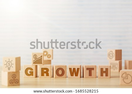 Growth wooden cubes on table #1685528215