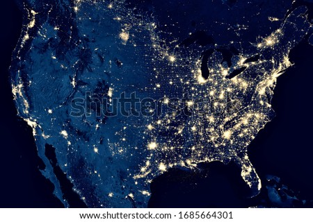 US map in on global satellite photo, view of city lights in United States from space. USA terrain on dark Earth, North America at night in world. Elements of this image furnished by NASA.