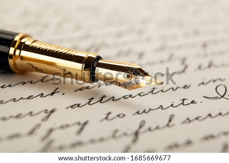 fountain pen on paper with ink text on the paper closeup Royalty-Free Stock Photo #1685669677