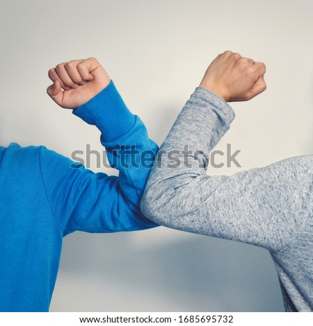 Elbow bump - a new and safe way of greeting to avoid the spread of coronavirus (COVID-19), an alternative to handshake and hugging  Royalty-Free Stock Photo #1685695732