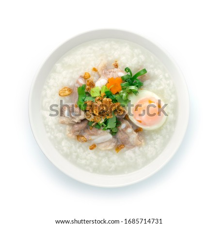 Rice Porridge with Pork Cartilage or Soft Spareribs Pork and Boiled Egg ontop spring onions,carrot and Celery cutlet is a classic Boiled Rice Food Asian breakfast dish made by boiling rice  #1685714731