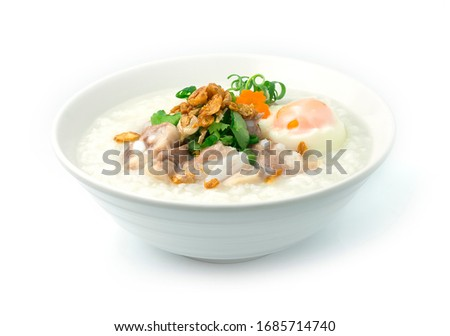 Rice Porridge with Pork Cartilage or Soft Spareribs Pork and Boiled Egg ontop spring onions,carrot and Celery cutlet is a classic Boiled Rice Food Asian breakfast dish made by boiling rice  #1685714740