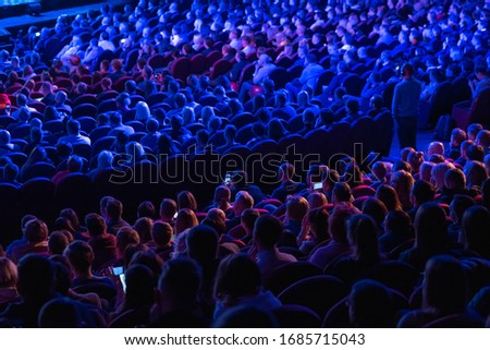 Business conference attendees sit and listen to lecturer, rear view Royalty-Free Stock Photo #1685715043
