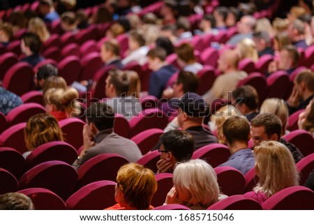 Business conference attendees sit and listen to lecturer, rear view #1685715046