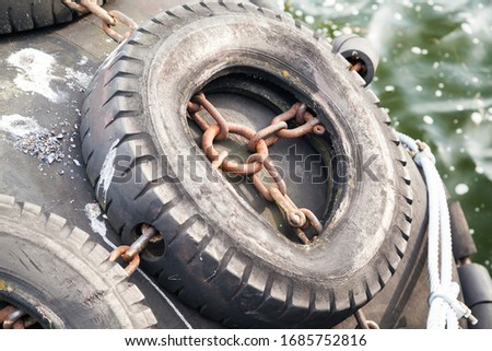 Picture of a tire used as a ship fender in a harbour
