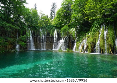 Turquoise lake and chain of waterfalls inside Plitvice Lakes National Park #1685779936