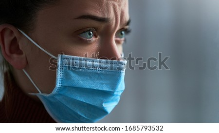Upset depressed sad sorrowful crying woman in protective mask with tears eyes during illness, coronavirus outbreak and flu covid epidemic. Life difficulties and health problems. Copy space #1685793532