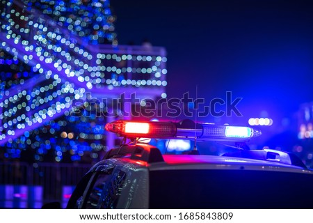 police car lights in the night city background