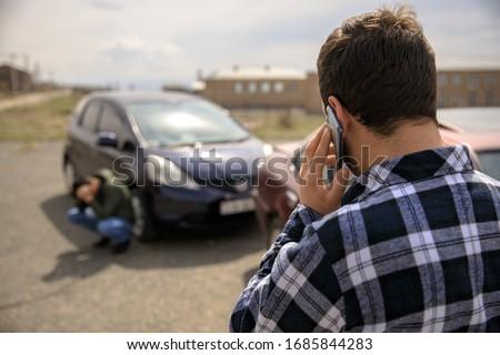 Sad man calling roadside service after car crash Royalty-Free Stock Photo #1685844283