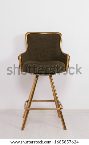 green bar stool with soft upholstery and gold legs on a white background #1685857624