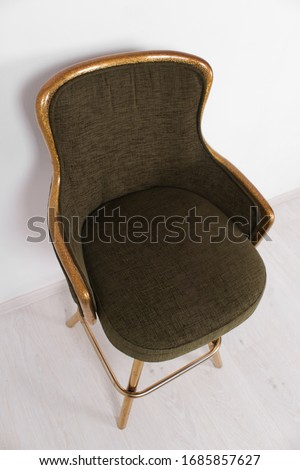 green bar stool with soft upholstery and gold legs on a white background #1685857627