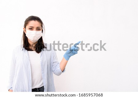 Medical worker female doctor or nurse in a protective mask and in medical gloves on a white background #1685957068