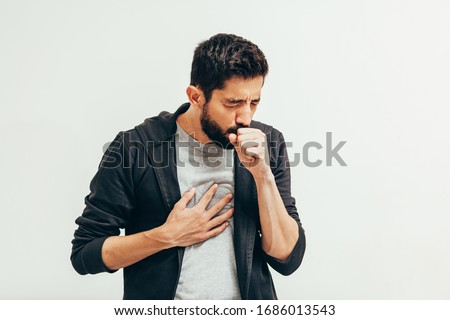 Sick man coughing over his hand. Coronavirus, covid-19 concept Royalty-Free Stock Photo #1686013543