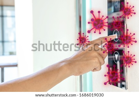 Man hands finger press button in elevator with virus. Covid-19 or Coronavirus in the elevator button that are touching hands. Button with virus around the elevator or lift. Royalty-Free Stock Photo #1686019030