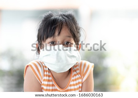 Young girl wearing masks to prevent disease #1686030163