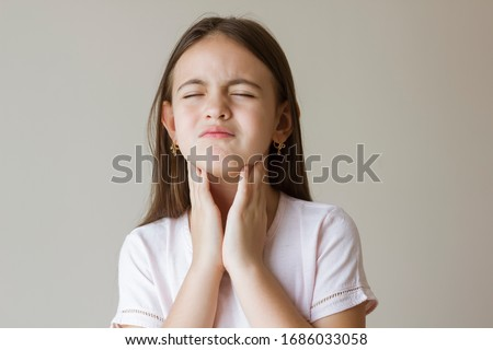 Little girl with sore throat touching her neck.Sore throat sick.Little girl having pain in her throat Royalty-Free Stock Photo #1686033058