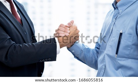 Business people shake hands when reaching a business agreement together. Royalty-Free Stock Photo #1686055816
