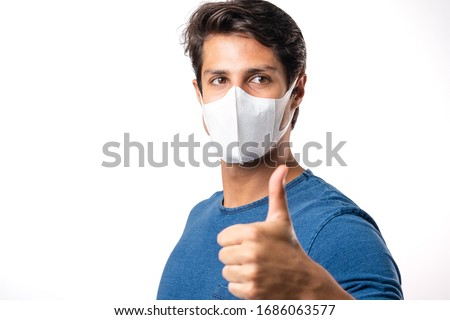 Handsome man brazilian showing okay gesture. Photo of healthy man wears protective mask against infectious diseases and flu. Health care concept.Mask prevent Covid 19 OK Leave space White background #1686063577