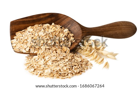 oat flakes in wooden scoop and ripe ears isolated on white background #1686067264