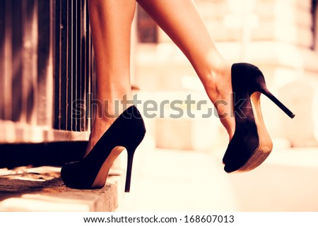 woman legs in high heel shoes outdoor shot Royalty-Free Stock Photo #168607013