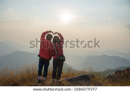 rear of happy couple love stand on top mountain looking view at Mulayit Taung, Myanmar. soft focus and vintage tone. #1686079597