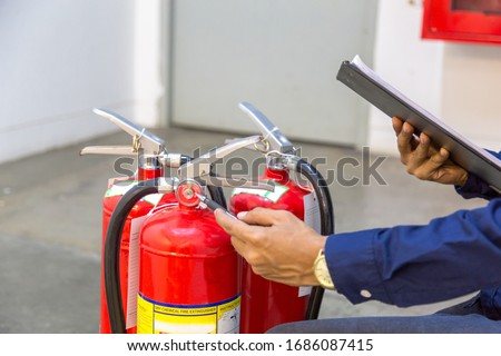 Engineer checking Industrial fire control system,Fire Alarm controller, Fire notifier, Anti fire.System ready In the event of a fire. #1686087415