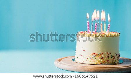 Delicious birthday cake with candle on light blue background.panoramic cover or banner concept. Royalty-Free Stock Photo #1686149521