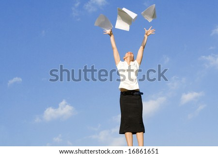 business woman throwing work papers in air #16861651