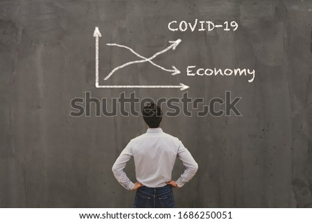 econimical crisis concept due to coronavirus COVID-19 spread in the world, virus curve up, economy down #1686250051