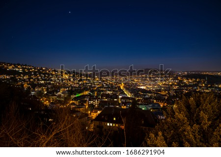 Germany, Famous skyline of stuttgart heslach houses, illuminated by night, aerial view above roofs, houses, streets with starry sky full of stars #1686291904