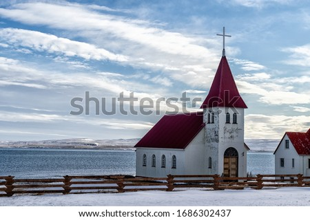 a lone church on a rocky shore #1686302437